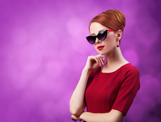 Beautiful redhead women on viloet background.