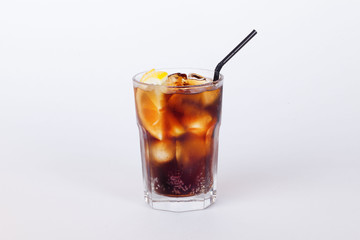 cola cocktail with lemon and ice