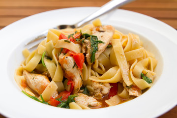 tagliatelle with chicken, vegetable and rucola