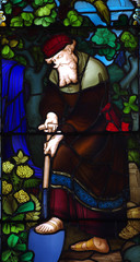 Man working in the garden. A stained glass window