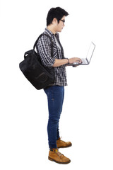 Male student using laptop computer