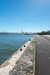 Quay with bridge over Tagus river in background, Lisbon (Portuga