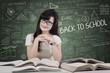 Pretty female student in classroom