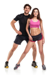 Athletic man and woman after fitness exercise on the white backg