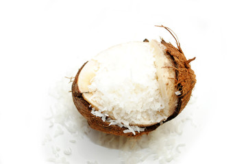Broken Coconut with Shredded Coconut Spilling Out