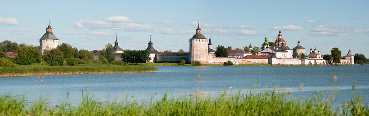 Ancient russian monastery at the lake bank in summer