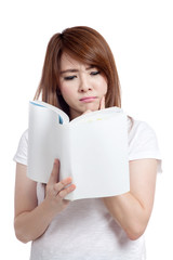 Asian girl think and reading book
