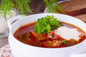 Borsch, soup from a beet, meat and cabbage with tomato sauce