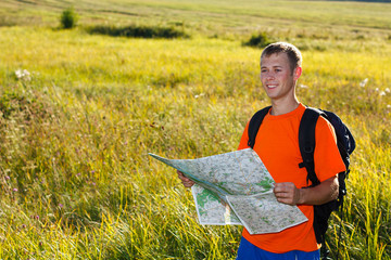 Man traveler with read the map and smiles