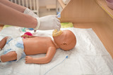 newborn resuscitation on a mannequin poster