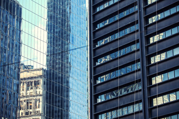 Two buildings glass walls.