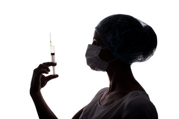Silhouette of doctor woman using syringe isolated on white