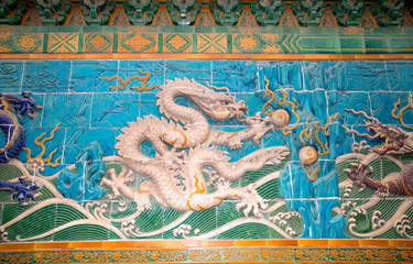 Dragon sculpture. The Nine-Dragon Wall (Jiulongbi)