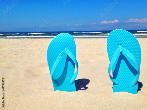 canvas print picture flip flops on the beach