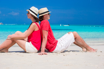 Happy young couple on tropical white beach