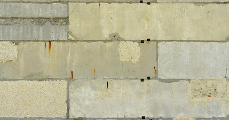 Old, cracked surface of concrete and bricks. Close up