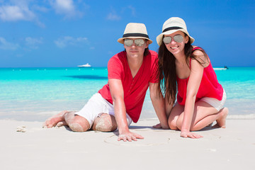 Close up of couple on tropical white beach