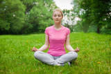 blonde girl outdoor in the park pink t-shirt. yoga