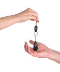 Woman giving car key to man