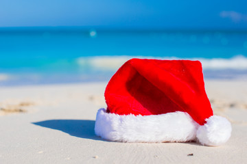 Close up Santa hat on a white sandy beach