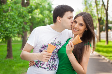 love couple out in the park with ice cream kissing