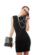 brunette  businesswoman in black dress holding telephone and tal