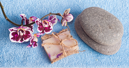 Spa stones, soap and pink orchid