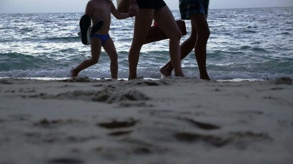 Family Walking at the Beach. Feet and Legs Only. Slow Motion.