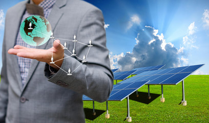 Solar farm with businessman carry virtual world