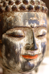 Colorful peaceful face of Buddha smiling