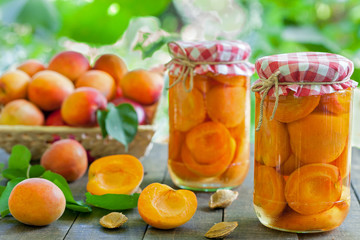 Apricot compote with fresh apricots in basket