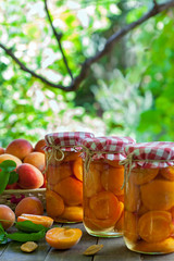 Apricot compote in the jars, vertical