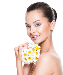 Smiling face of young beautiful woman holds posy flowers