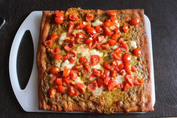 Italian Homemade Pesto and Tomatoes Pizza.