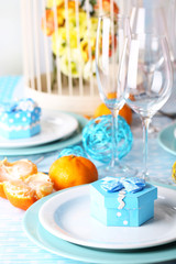 Table serving with colorful tableware close-up