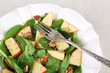Green salad with spinach, apples, walnuts and cheese