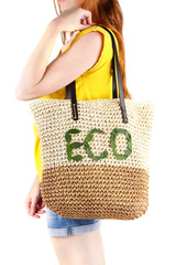 Woman with summer wicker Eco bag, on grey wall background