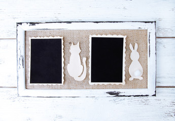 Wooden frames with blank old photo and paper animals