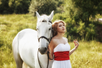 Beautiful sensual women with white horse