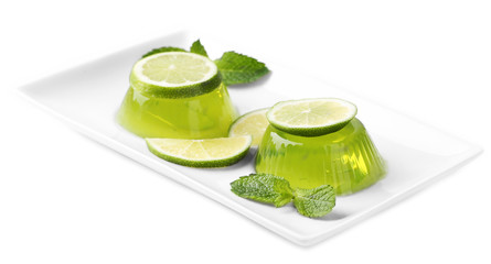 Green jelly with mint leaves isolated on white