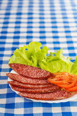 sliced ​​smoked sausage, tomatoes, lettuce
