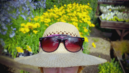 woman in straw hat in garden