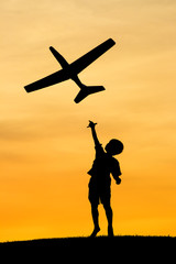 Boy launches toy plane.