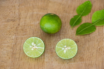 half lime on wooden background