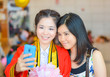 Graduate Thai college student photograph with her friend