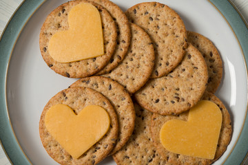 Heart shaped cheese on cracker
