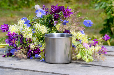 Metal mug with flowers