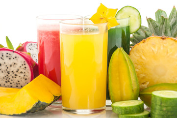 Raw fruit and fruit juice on white