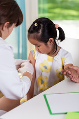 Asian girl during vaccine