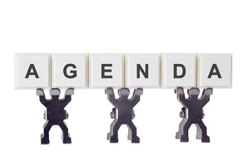 Figurine with the word AGENDA isolated on white background